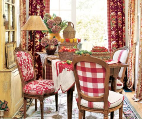 Living Room With Red Chairs And Curtains