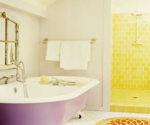 yellow shower and purple bathtub in a white bathroom