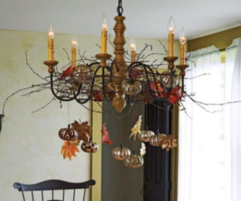 chandelier with pumpkins hanging on it