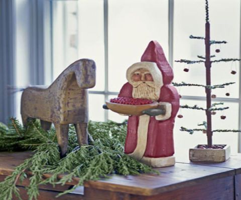 santa figure, horse, and small tree