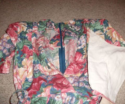 extra white fabric next to floral dress