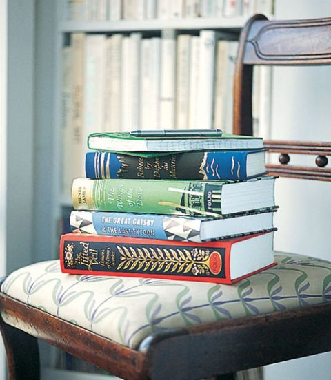 stack of books on a chair