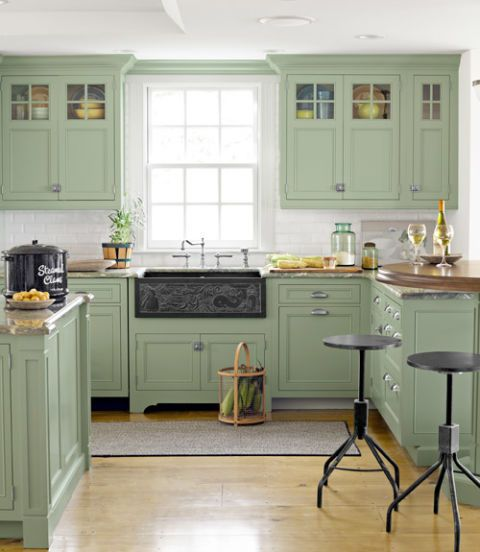 cape cod kitchen with green cabinets