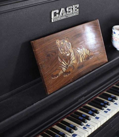 piano with tiger painting