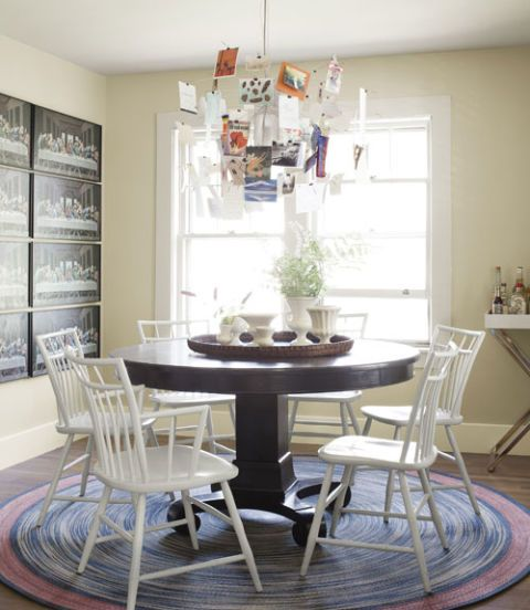 dining room with round table and modern chandelier