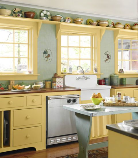 Kitchen With Green Walls And Yellow Cabinets
