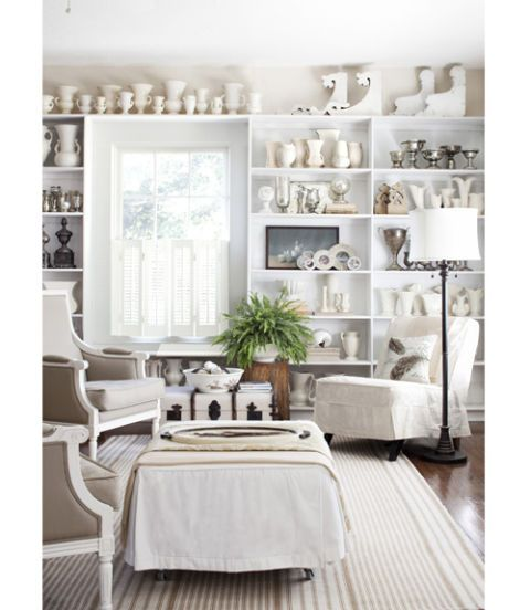 Good White Living Room With White Accessories On Wall