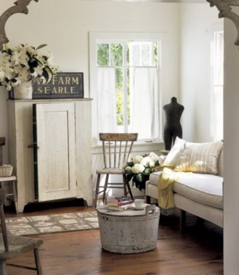 White Antique Looking Living Room With Wood Floors