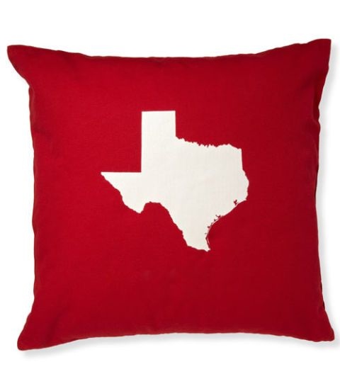 red pillow with teaxas state motif
