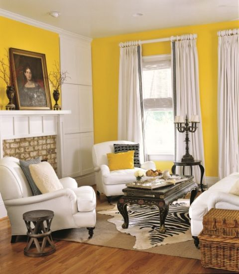 Living Room With Yellow Walls And Black White Furniture