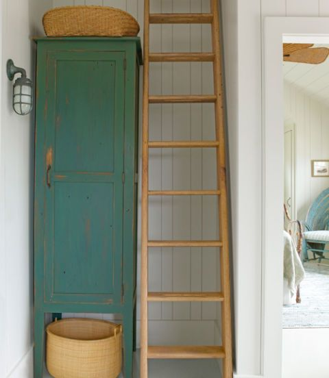 green cabinet and ladder