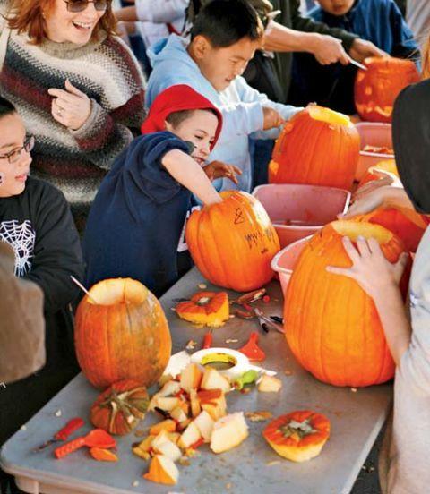 kids carving pumpkins together