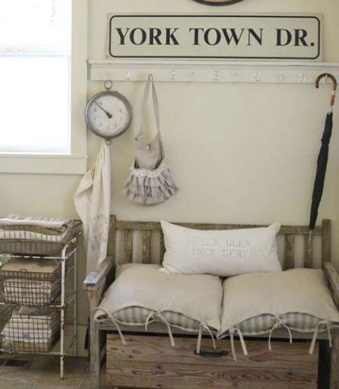 Room, Wall, Interior design, Grey, Pillow, Linens, Bedding, Clock, Still life photography, Wall clock,
