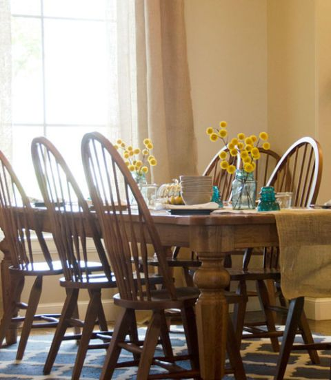 Yellow, Room, Furniture, Table, Chair, Dining room, Hardwood, Home accessories, Kitchen & dining room table, Bouquet,