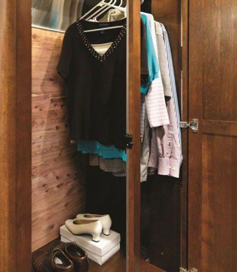 Clothes hanger, Room, Toilet, Hardwood, Wood stain, Closet, Ceramic, Toilet seat, Boutique, Fashion design,