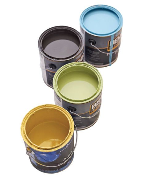 four cans of paint in blue brown green and yellow