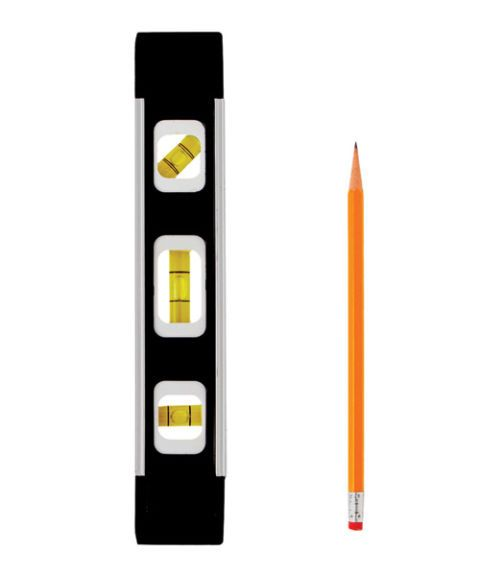 a level and a yellow pencil on white background