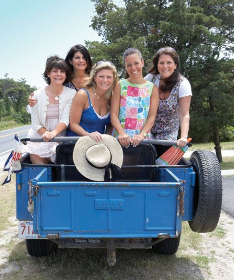 five girlfriends in the back of a blue truck