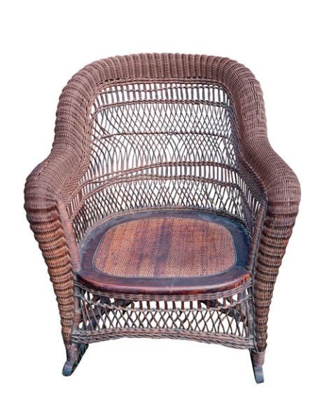 A Natural Colored Wicker Rocking Chair On White Background