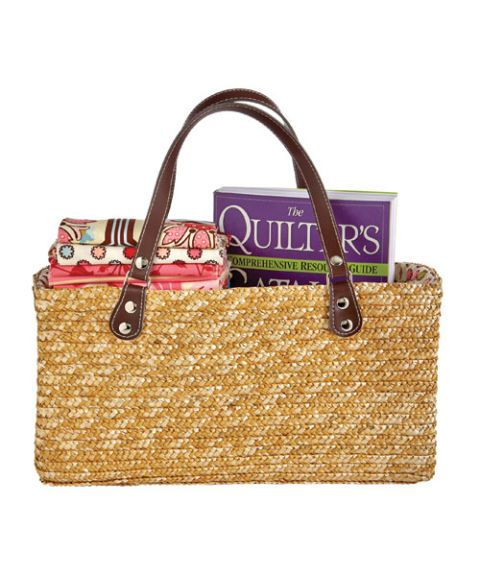 straw purse with quilting items inside