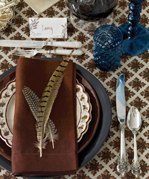 place setting with pheasant feathers