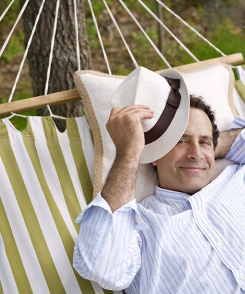 actor tony shalhoub with hat on hammock
