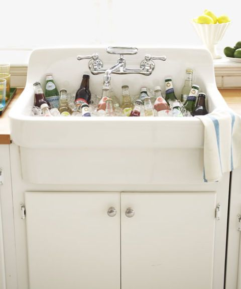 white sink filled with bottles