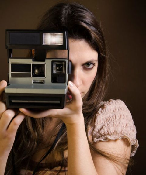 woman with polaroid camera