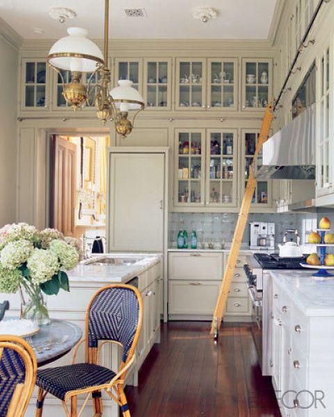 Room, Interior design, Yellow, Wood, Floor, Home, Furniture, Light fixture, Drawer, Ceiling,