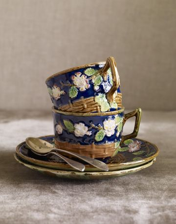 teacups with cherry blossoms and picket fence design