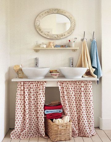 Two Red And White Sink Skirts Hanging From A Sink Countertop In A Bathroom