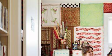 sandy stone examines textiles in her home studio