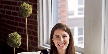 Entrepreneur Rebecca Kousky sitting with her laptop
