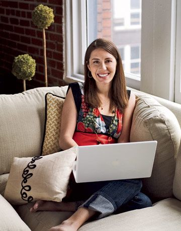 Entrepreneur Rebecca Kousky sitting with her laptop