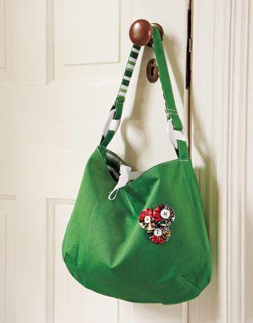 Green canvas handbag with decorative fabric yo-yos