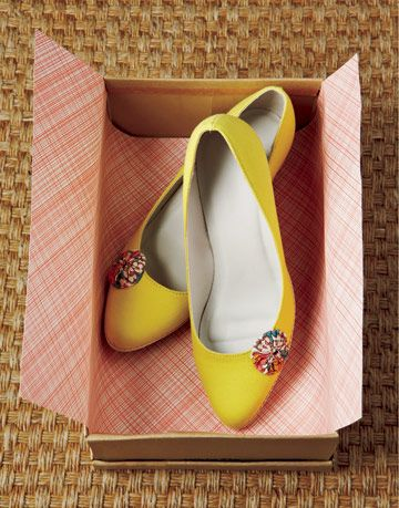 Flat yellow shoes decorated with fabric yo-yos
