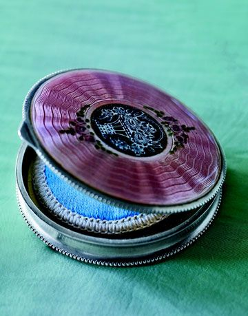 a purple enameled powder compact