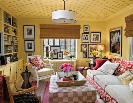 family room with white and red patterned furniture and golden walls