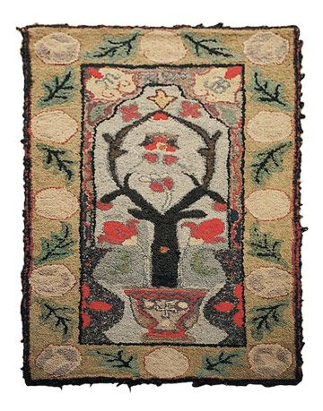 hooked rug with tree motif
