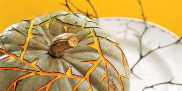pumpkin with carved thorny vines