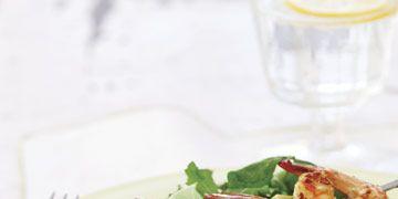 salad with grilled shrimp on a skewer