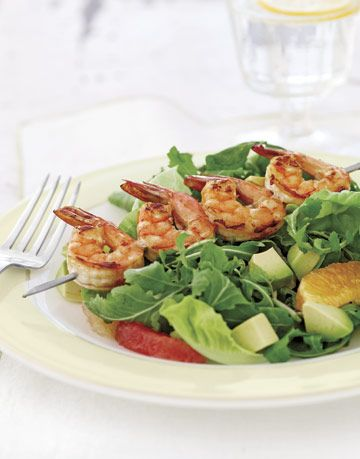 salad with grilled shrimp on a skewer