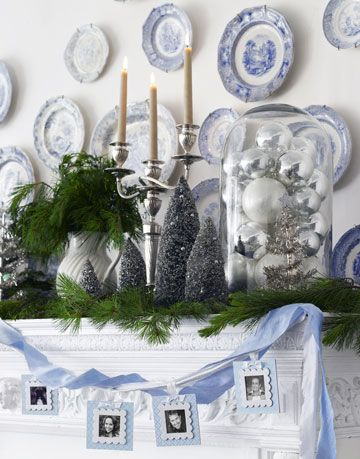 mantel with greenery and silver ornaments and mini trees