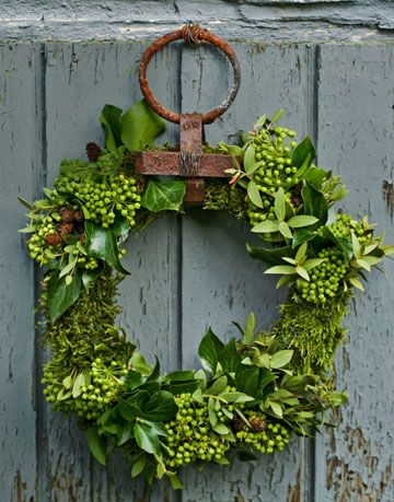 green wreath held up with an iron ring