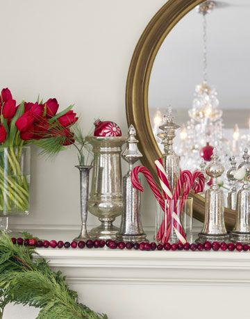 mantel with a glass of candy canes and silver