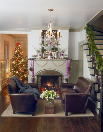 living room with brown leather couches and christmas decorations