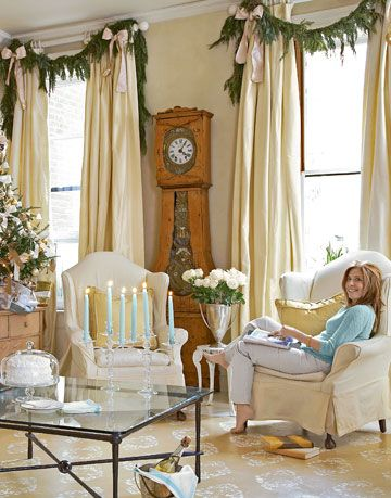 woman sitting in a chair in a white living room