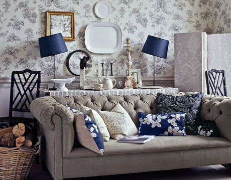 living room with sofa and toil wallpaper