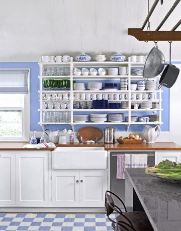 blue and white kitchen with shelves