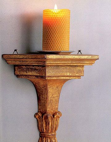 beeswax rolled candle on pedestal